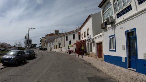 Ferragudo, Algarve, south of Portugal - March - 2018: Driving trought Ferragudo, located in the Algarve coast, south of Portugal.  Once a small fishing village, now become a cosmopolitan resort.