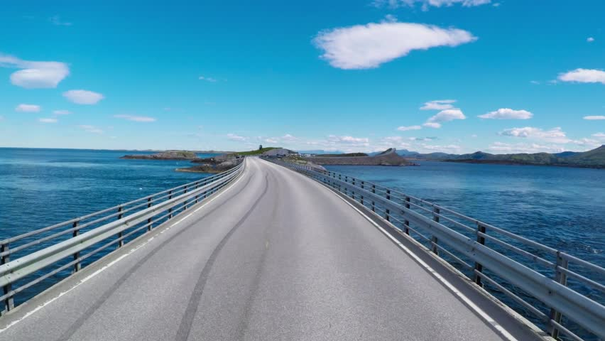 Driving a Car on a Road in Norway Atlantic Ocean Road or the Atlantic Road (Atlanterhavsveien) been awarded the title as (Norwegian Construction of the Century).