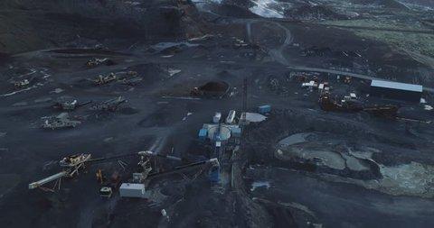 Aerial: Gravel quarry in lava field. Black gravel.
