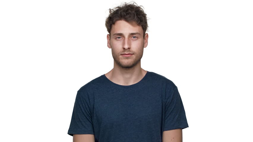 Portrait of brunette handsome guy having bristle nodding and expressing approval, isolated over white background in studio closeup. Concept of emotions