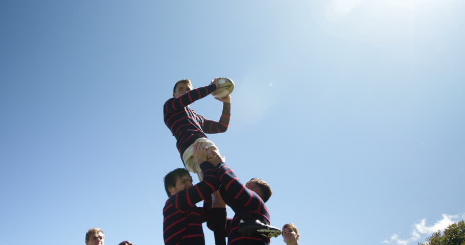 Rugby players practicing to defend the ball on a sunny day 4K 4k | Shutterstock HD Video #1009870493