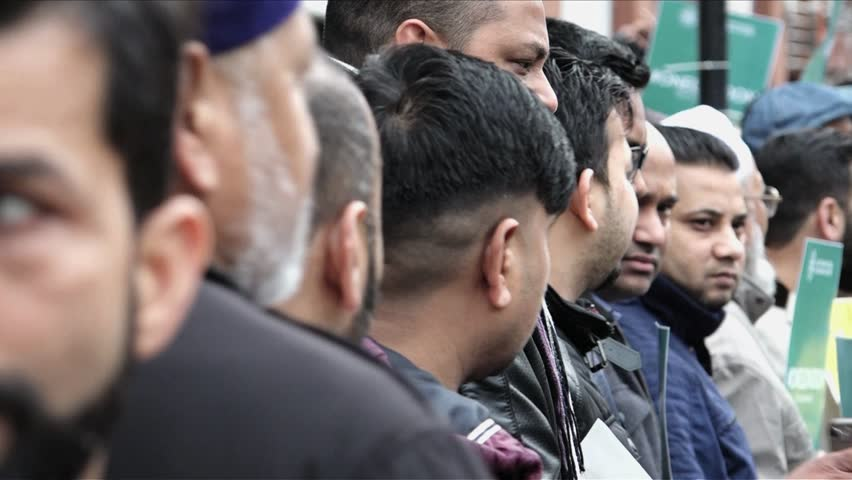 London, United Kingdom (UK) - 04 03 2018: Muslim men standing in a line | Shutterstock HD Video #1009895699