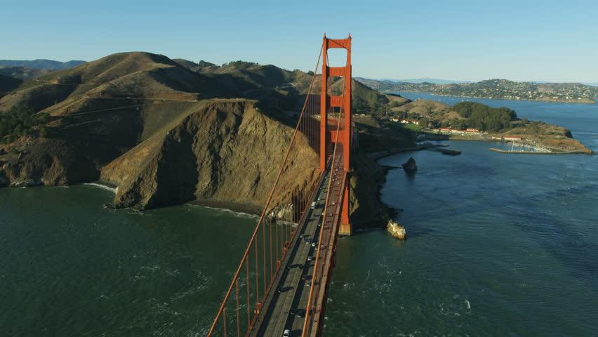 Aerial sunlight view of the Golden Gate road traffic Bridge US 101 Marin Headland vista Point shoreline San Francisco Pacific ocean California USA