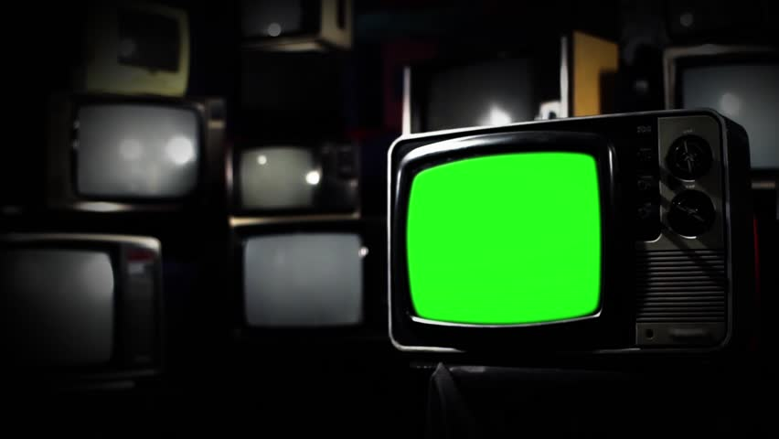 "TV of the 1980s with Green Screen over a Retro TV Wall. Dark Tone. Zoom In. You can replace green screen with the footage or picture you want. You can do it with ""Keying"" effect in After Effect. 