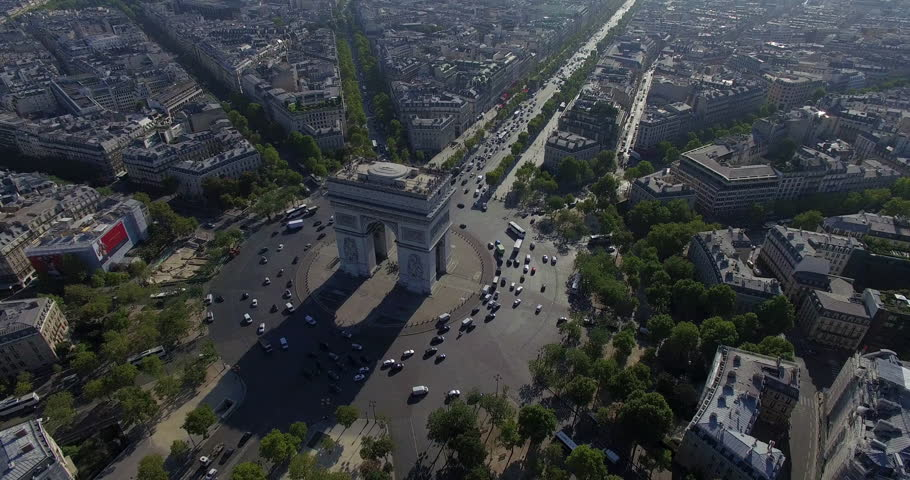 PARIS, FRANCE – SEPTEMBER 2016 : Aerial view over Triumphal Arc traffic on a beautiful day with view of central Paris cityscape | Shutterstock HD Video #1009990580
