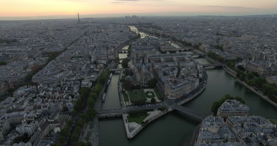 PARIS, FRANCE – SEPTEMBER 2016 : Aerial shot over central Paris island at sunset with view of Notre Dame, Eiffel Tower and river Seine | Shutterstock HD Video #1009990712