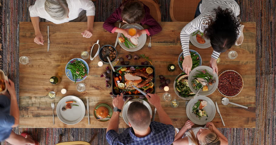 Top view of family preparing table enjoying delicious vibrant thanksgiving meal together tasty homemade lunch time lapse