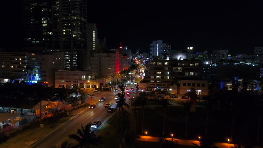 Aerial night Miami Beach Collins avenue weekends