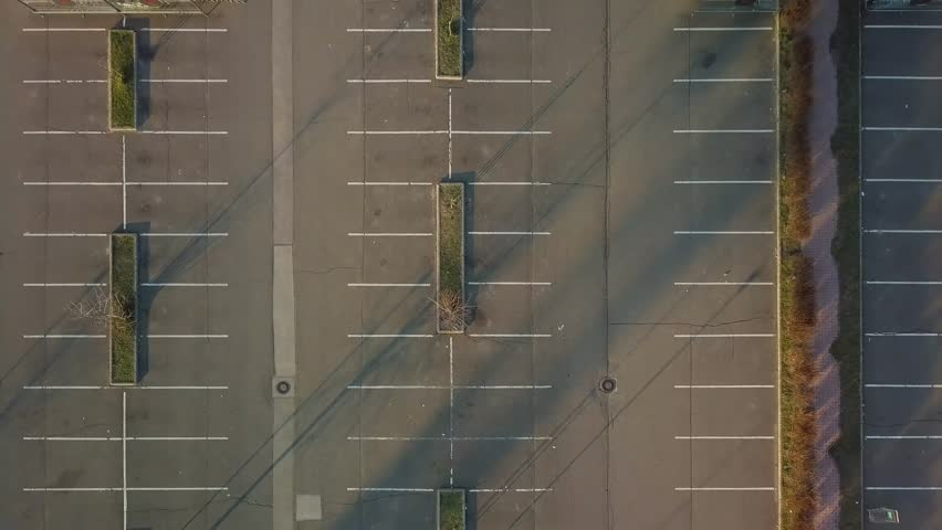 Aerial footage of empty parking lot Royalty-Free Stock Footage #1010020106