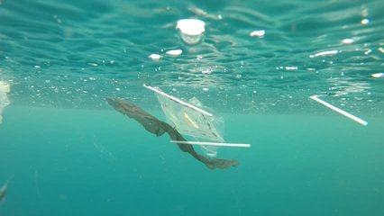 Plastic pollution in ocean environmental problem. Plastic cups,carrier bags, bottles and straws dumped in sea