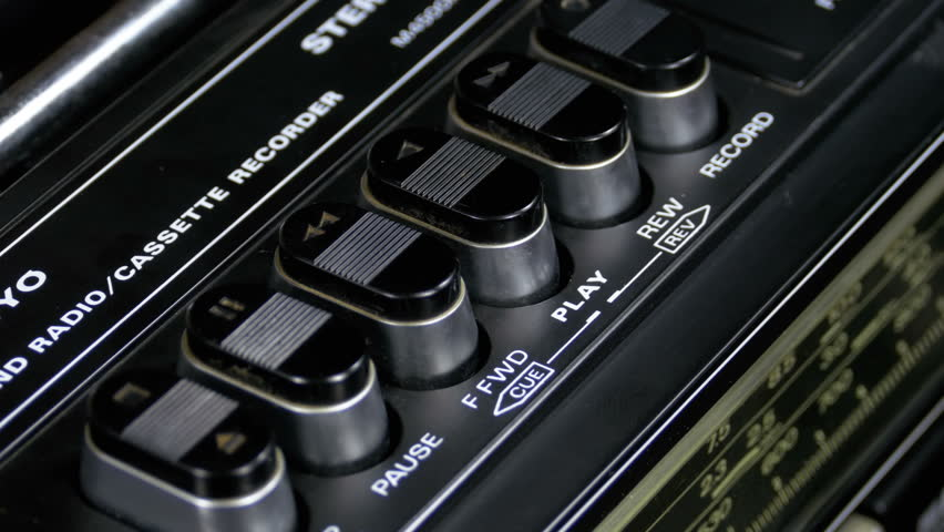 Pushing Button on a Tape Recorder, Play, Stop, Rec, ff, Rew. Close-up. Man finger presses playback control buttons on vintage audio cassette player. | Shutterstock HD Video #1010027489
