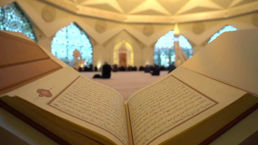 Quran or Koran - holy book and Muslim People praying in Mosque with sound  ISTANBUL, TURKEY - MARCH 2018   Shutterstock HD Video #1010030399