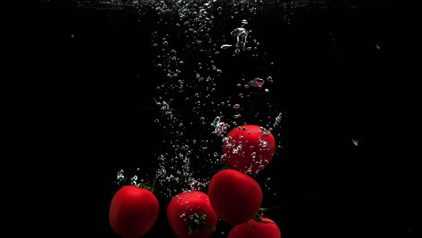 Red ripe tomatoes splash in water with air bubbles and droplets | Shutterstock HD Video #1010034317