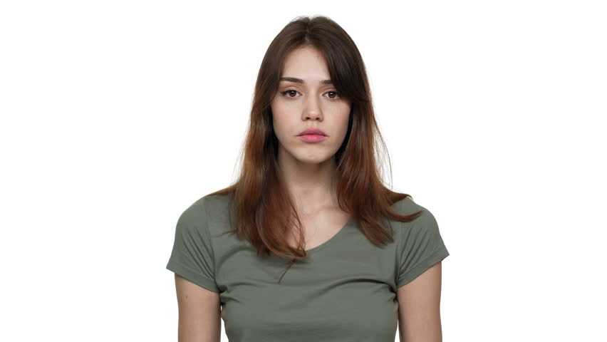 Portrait of content confident woman wearing basic t-shirt nodding and agreeing with interlocutor, isolated over white background in studio. Concept of emotions | Shutterstock HD Video #1010036171
