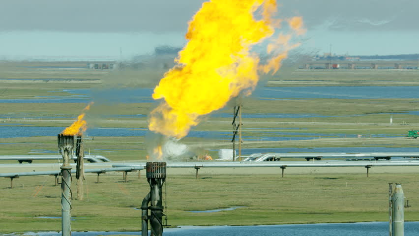 Aerial view Deadhorse Prudhoe Bay gas flame off North Slope companies operate Industrial Oil fields Arctic circle Alaska USA