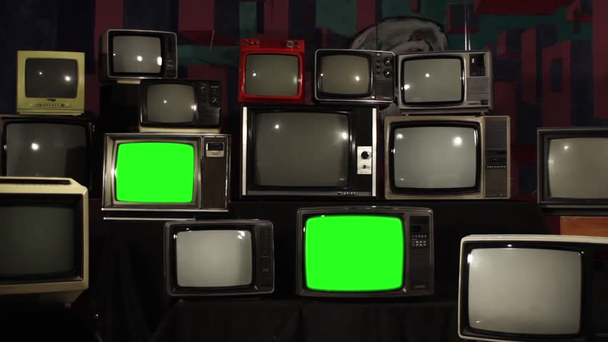 "Pile of Four Retro TVs turning Off Green Screen. Aesthetic of the 80s. Zoom out. You can Replace Green Screen with the Footage or Picture you Want with ""Keying"" effect in After Effects. 
