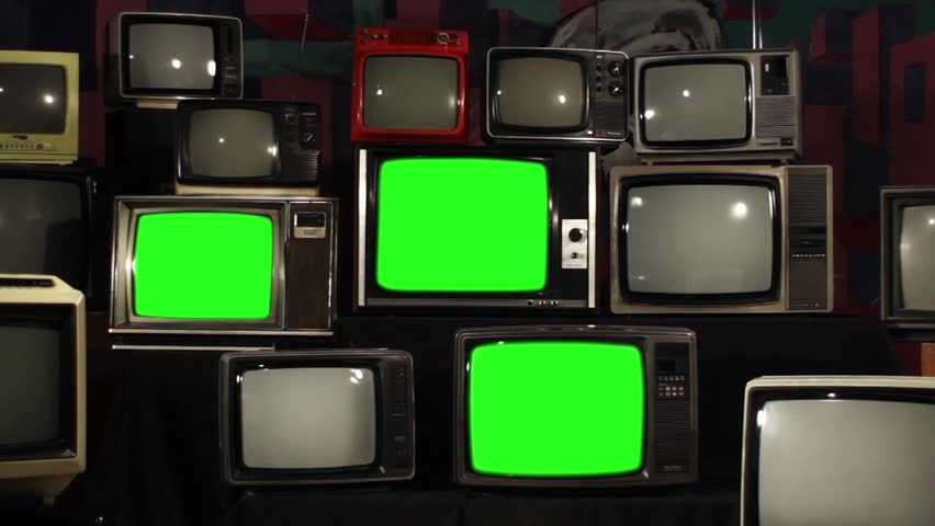 "Four 80s TVs Turning On Green Screens.  Fast Zoom In. You can Replace Green Screen with the Footage or Picture you Want with ""Keying"" effect in After Effects (check out tutorials on YouTube). 