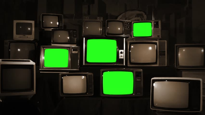 "Four Retro TVs with Green Screen among Old TVs. Sepia Tone. Slow Zoom In. You can Replace Green Screen with the Footage you Want with ""Keying"" effect in After Effects (check out tutorials on YouTube). 