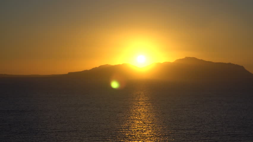Rising Sun over the sea and desert mountains | Shutterstock HD Video #1010057774