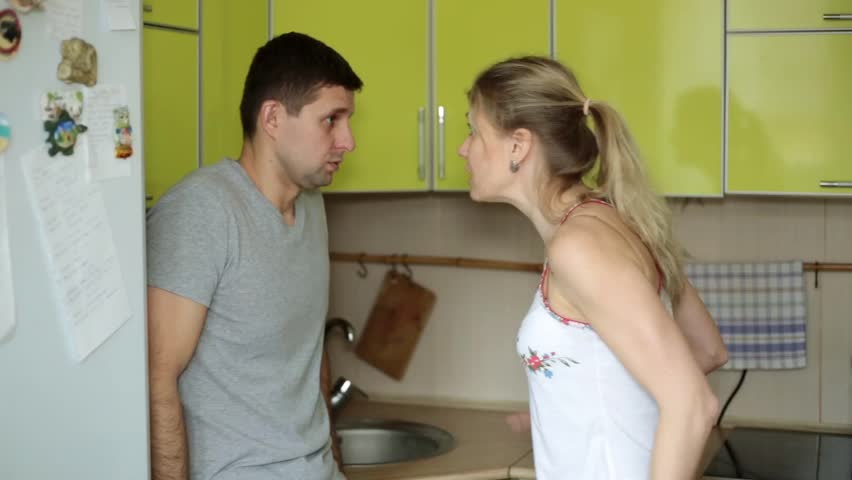 Family quarrel, conflict. Husband and wife swear at home.