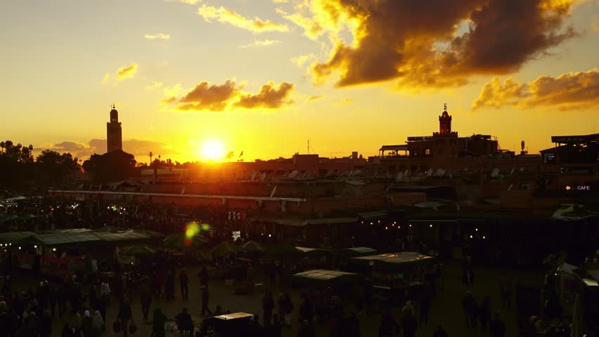 Famous Jemaa el Fna square crowded at sunset, Marrakesh, Morocco, timelapse 4k