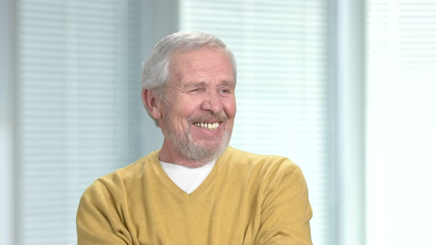 Smiling senior man looking at camera. Portrait of happy older male person. Positive elderly man. People, emotions, expressions. | Shutterstock HD Video #1010093015