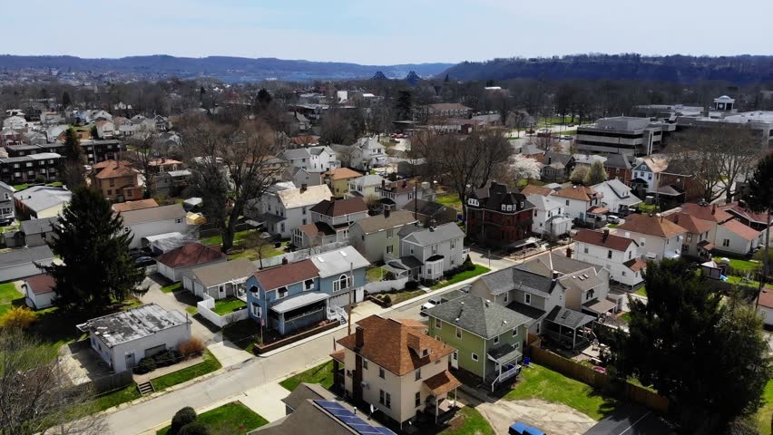A fast flyover of a small town in the Ohio Valley area of Western Pennsylvania. Pittsburgh suburbs.