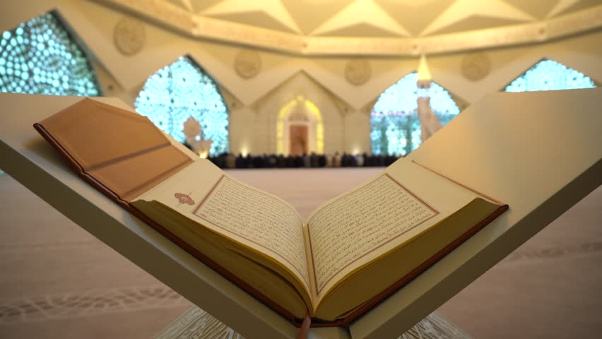 Quran or Koran - holy book and People praying in the blue mosque in istanbul noon prayer in congregation male Muslims Fatih Mosque Sultanahmet 4k sun rays with Sound  ISTANBUL, TURKEY - MARCH 18   Shutterstock HD Video #1010100038