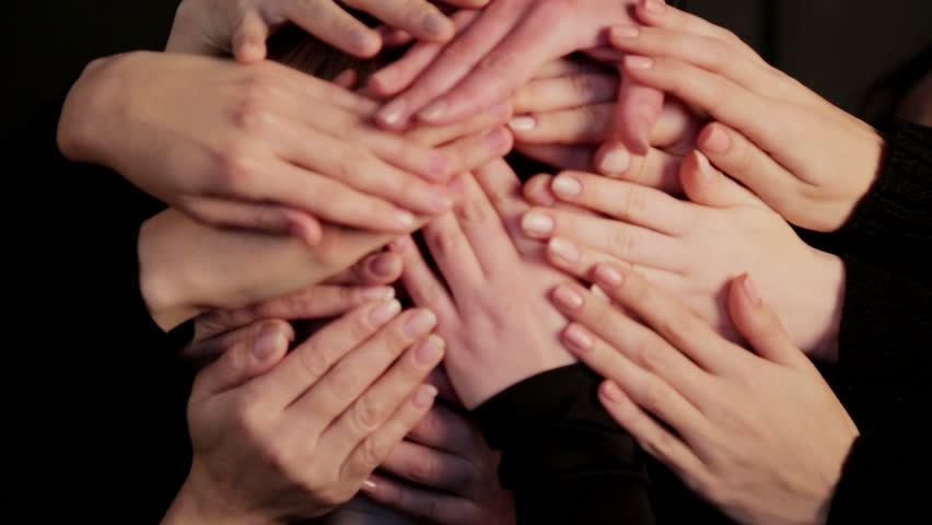 The face of the girl close up is closed by a multitude of hands. Portrait of a womans face hidden in a multitude of hands. | Shutterstock HD Video #1010105117