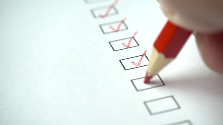 A person checking off a to do list with red pencil. Check all the boxes of a checklist, close-up, 4k