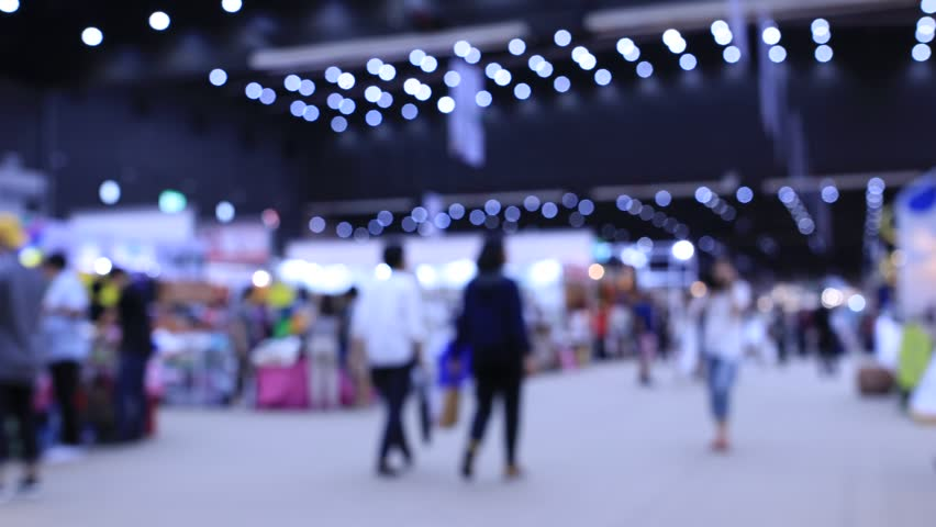 the International export import trade fair hall with many creative customers, business buyers, modern visitors, press and exhibitor stands from around the world, Blurred Background Time lapse motion Royalty-Free Stock Footage #1010113100