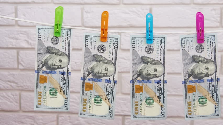 The cash hangs on the rope. Pure money. | Shutterstock HD Video #1010132798