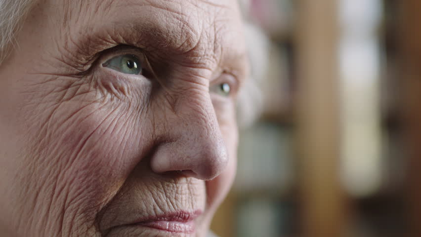 Close up portrait of elderly caucasian woman pensive contemplative looking up lonely hopeful old age retirement