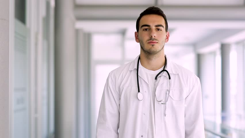 Young Doctor Holds Stethoscope | Shutterstock HD Video #1010147546
