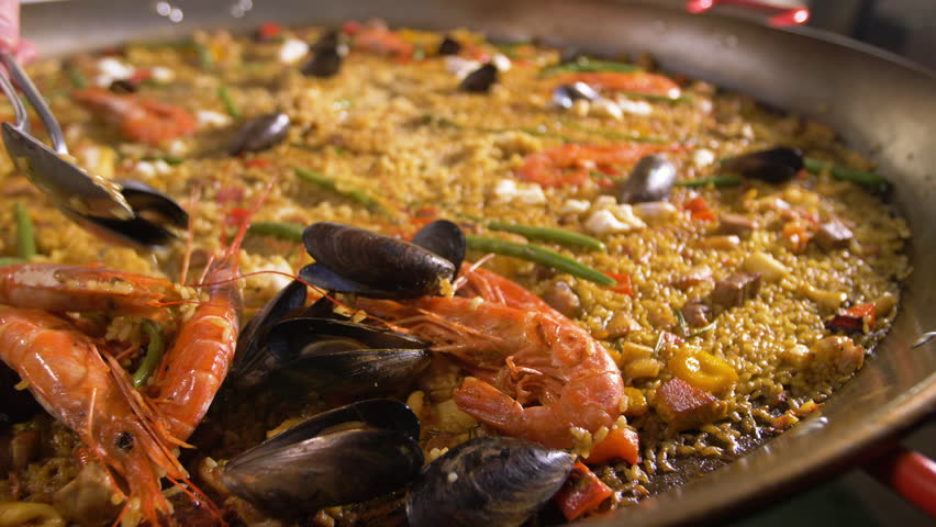Ready Spanish paella. Separation of seafood from vegetables and rice.