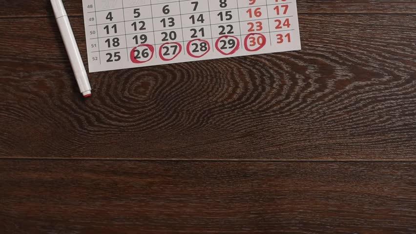 Underwear, a calendar with menstruation dates, hygiene tampons and gaskets | Shutterstock HD Video #1010180021