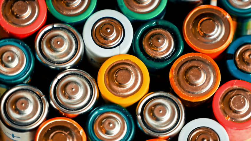 Used batteries from different manufacturers, waste, collection and recycling, high danger for the environment. Batteries background
