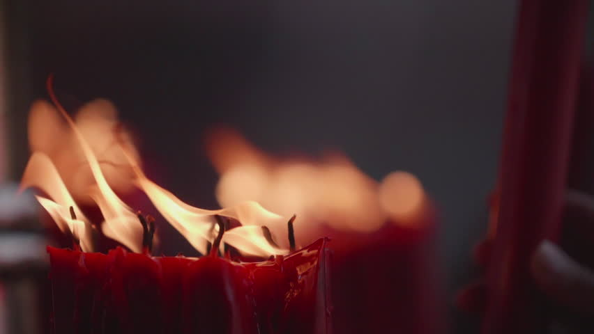 People light up candle in slow motion
