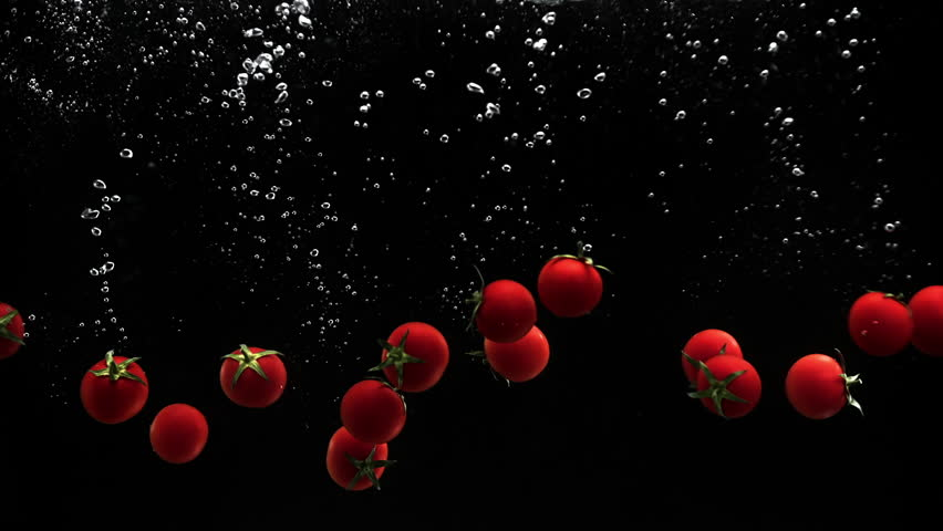 Fresh vegetables cherry tomatoes falling in water on black background | Shutterstock HD Video #1010218760
