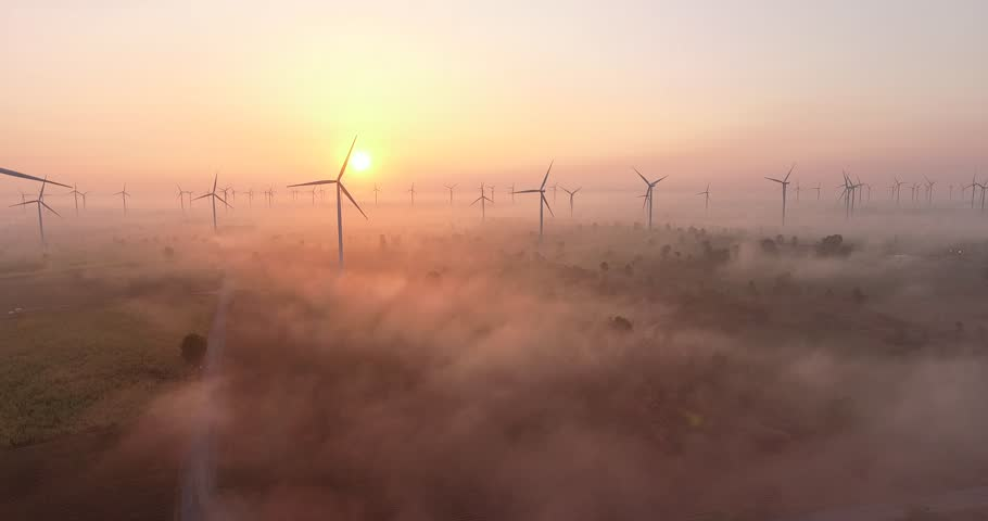 Aerial view of Wind turbines Energy Production- 4k aerial shot on sunset. 4k drone footage turbines at sunrise with clouds | Shutterstock HD Video #1010225909