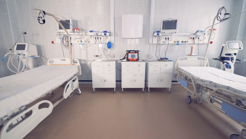 Two empty bed in a hospital room with medical equipment. Coronavirus, COVID-19, 2019-nCoV concept.