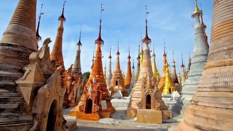 The rows of small stupas, decorated with hti decorative umbrellas and bells in archaeological and religious site of Shwe Inn Dein Pagoda, Inn Thein (Indein) village, Inle Lake, Myanmar.