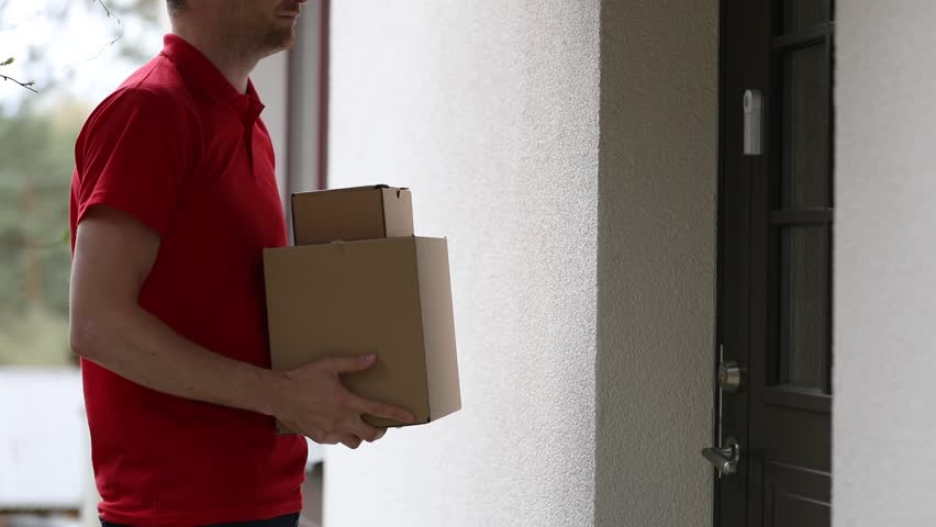 home delivery service - accepting a delivery of boxes from deliveryman