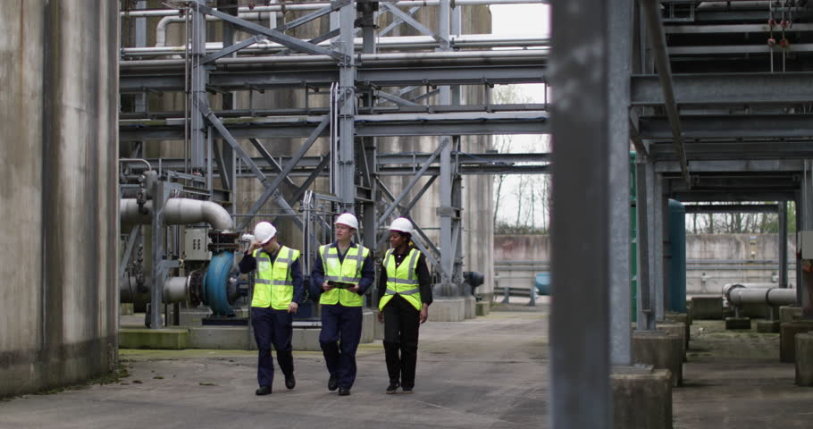 Industrial workers being trained using a digital tablet on site Royalty-Free Stock Footage #1010254688