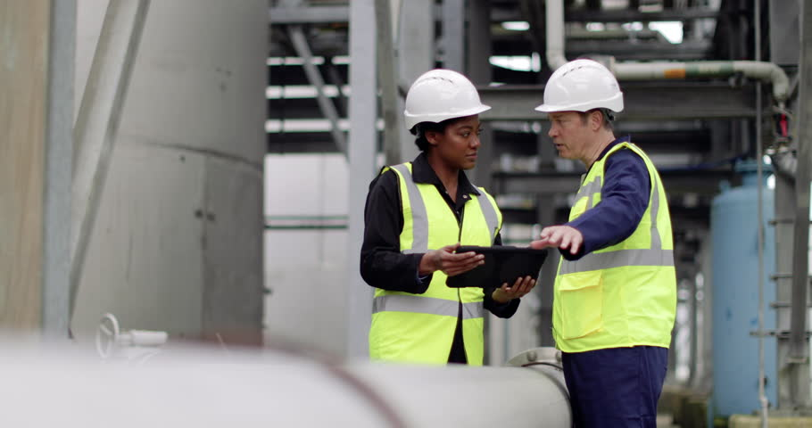 Industrial workers using a digital tablet on site Royalty-Free Stock Footage #1010254706