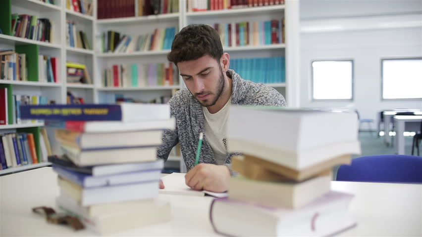 Student reading book in school library. Study lessons for exam. Hard worker concept. | Shutterstock HD Video #1010262815