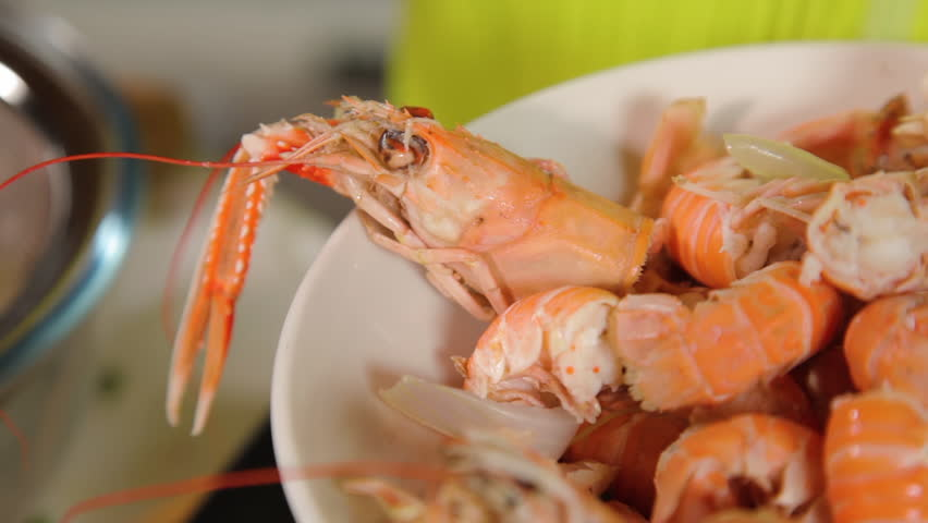 A close up shot of prawns to be prepared for cooking a meal out of it.   Shutterstock HD Video #1010269355