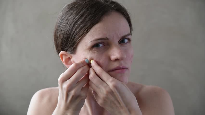 Beautiful young brunette girl with pimples and acne on her back and face | Shutterstock HD Video #1010286026