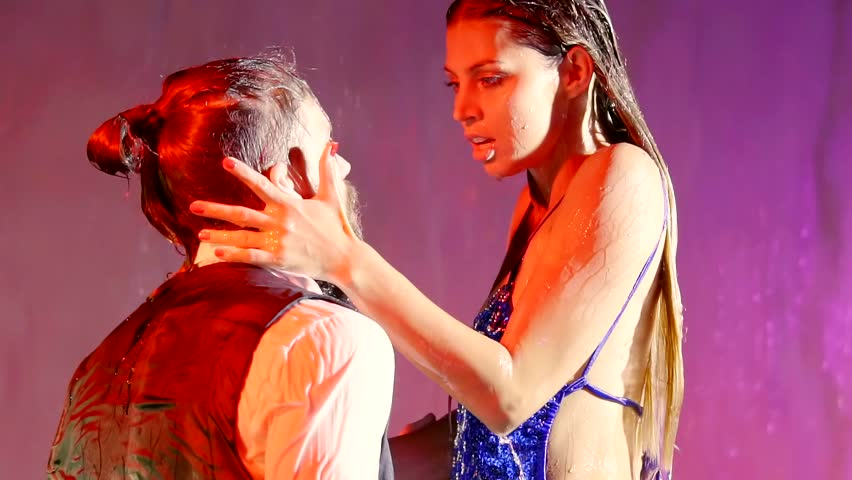 Erotic shots of filming during the dance of a married couple in the water, a woman pulls her hands towards the man | Shutterstock HD Video #1010307608