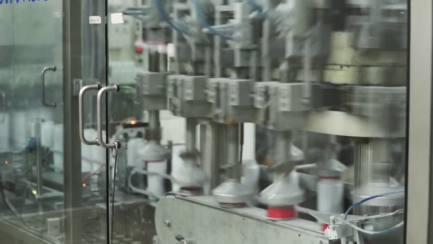 Factory for the production of medicines, glass bottles on the conveyor. Clip. For the production of plastic bottles and bottles on a conveyor belt factory